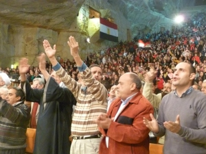 One of the purposes of the event, besides praying for Egypt, was to broadcast the love Copts have for their nation. Note how many Egyptian flags filled the auditorium.