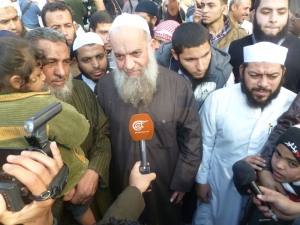 After a little while the star of the show arrived. Mohamed al-Zawahiri is the brother of Ayman, the leader of al-Qaeda. Everyone pressed around him.
