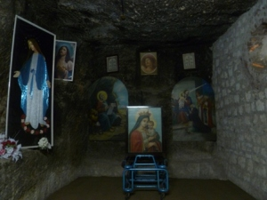 ... this cave, where the Virgin Mary is said to have appeared in an apparition. (Is that redundant?)