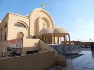 St. Michael's Church. The sign to the bottom left says 'Come to me', with Jesus speaking to Maspero martyrs.