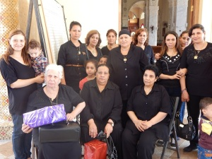 Relatives of the martyrs, dressed in black.