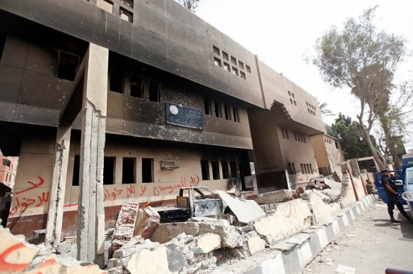 A view shows a damaged police station burnt in a blaze by supporters of former president Mohamed Mursi in Kerdasa, a town 14 km (9 miles) from Cairo in this September 19, 2013 file photograph. REUTERS/Mohamed Abd El Ghany
