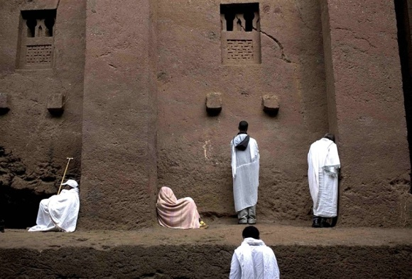 Ethiopian Christians at prayer at a rock-cut church, via NBC news photo blog.