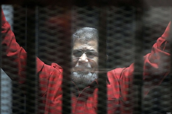 Former President Mohamed Morsi, wearing the red uniform of a prisoner sentenced to death