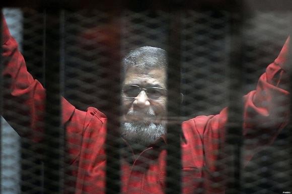 Former President Mohamed Morsi, wearing the red uniform of a prisoner sentenced to death