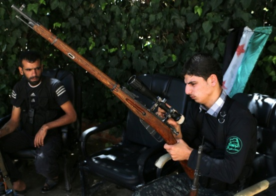 A fighter from the Nureddine al-Zinki unit, a moderate Syrian opposition faction affiliated with the Muslim Brotherhood and made up of former Syrian Free Army fighters at odds with the radical Islamic State jihadists, checks a WWII soviet-era Mosin Nagant sniper rifle at the Sakhur frontline, near the northern Syrian city of Aleppo on 11 September 2014 (AFP) - See more at: http://www.middleeasteye.net/news/syrias-muslim-brotherhood-appoints-new-leader-1320475160#sthash.GICBoIS1.dpuf