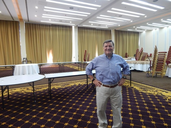 Jim Burgess, pastor of the Fellowship of the Emirates, inside the not-yet-set-up church hall.