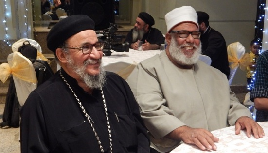 Sheikh Abdel Rahman (R) and Fr. Suriyal