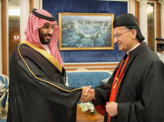 Saudi Crown Prince Mohammed bin Salman shakes hands with Lebanese Maronite Patriarch Bechara Boutros Al-Rahi during their meeting in Riyadh